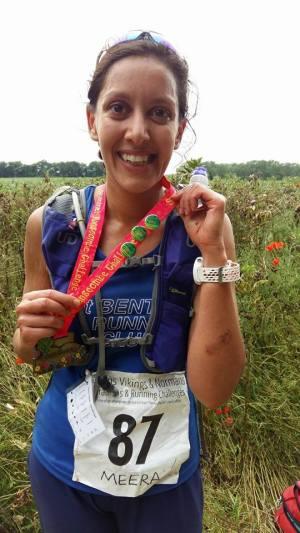 Ultra-marathoner Meera Rajoo-Oakley donning her medal and winner's badge