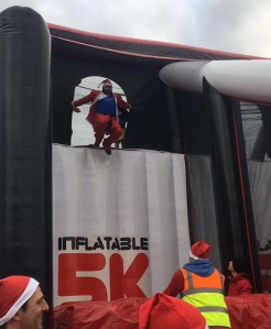 Mark takes on the 'Leap of Faith' at the Inflatable Santa 5k Run in Ipswich