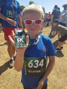 A proud Jamie with his first 5km medal!