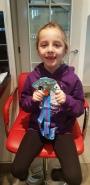 Ella's first half medal