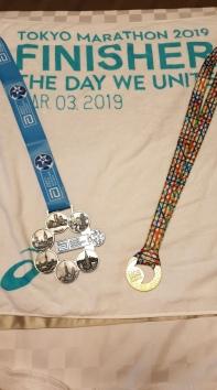 Six Star and Tokyo Marathon medals.