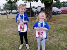 Amelia and Imogen happy with their medals.